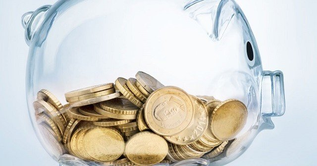 52519476 - a see through piggy bank with money coins