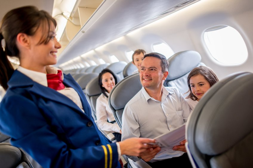 Flight Attendant Catering the Passenger's Needs
